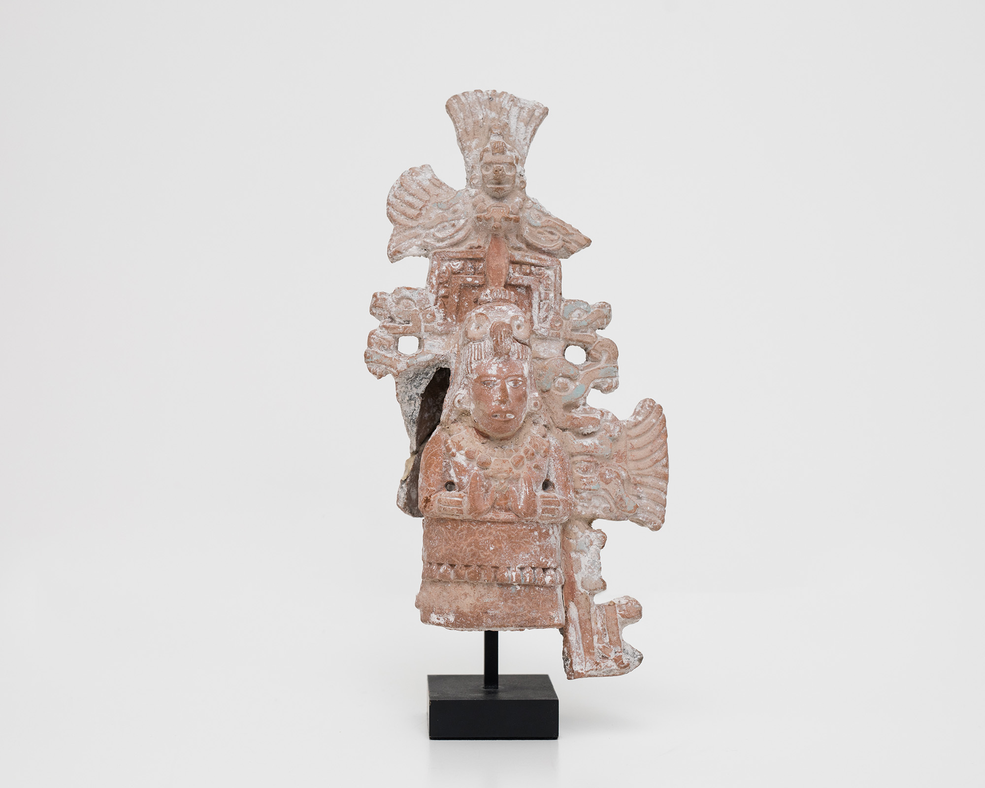 Mayan, Campeche, <i>Standing Priest with Elaborate Headdress with Rain-God Tlaloc extending from side</i>, ca. 700–900 AD. Eli and Edythe Broad Art Museum, Michigan State University, purchase, funded by the MSU Development Fund. Photo: Eat Pomegranate Photography