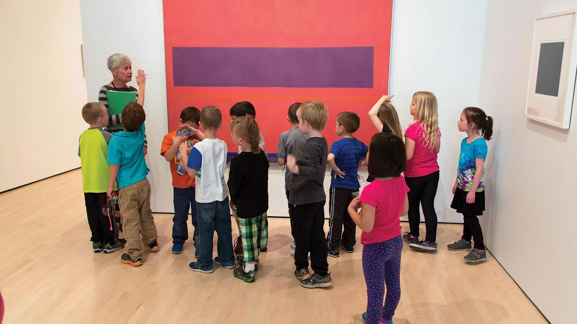 Children getting a tour of an art gallery